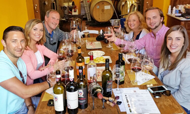 Guests enjoying their Tuscany wine tasting tour in Chianti Italy