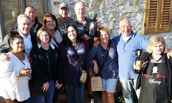 Group of People at a Wine Tasting in Tuscany