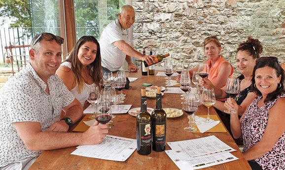Tuscany Wine Tour Guests Enjoying Tasting